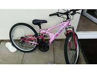 Girls cycle in pink