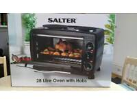 Mini oven with twin hobs