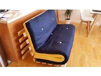 Double navy blue futon includes memory foam mattress topper