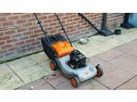 Flymo push type petrol mower