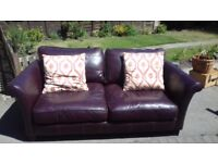 2 seater leather sofa in good condition with cushions