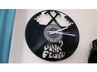 PINK FLOYD WALL CLOCK. DARK SIDE OF THE MOON VINYL DISC.