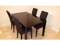 Black metal & glass kitchen/dining table & 4 upholstered chairs.