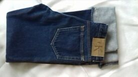 Calvin Klein ladies jeans size 8. Never worn.