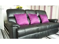 Real Leather Black Suite in very good condition just 2 years old recliners on couch and chair