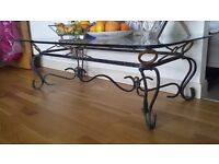 glass coffee table with solid iron base