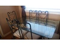 Stylish Glass to dinning table and 6 chairs