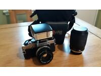 Olympus OM20 SLR 35mm camera with lenses, flashgun and bag