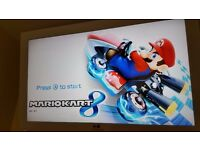Wii u Console with Mario Kart 8 on hard drive! & 10 games!