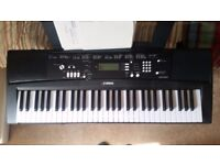 Almost New Yamaha EZ-220 Keyboard with stand!