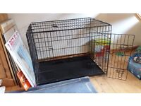Two dog cages both in good condition, the photo is of the smaller one.