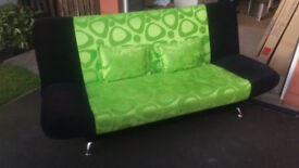 green and black sofa bed