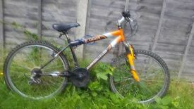 A ORANGE AND BLACK BICYCLE