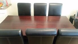Solid wood dining table and six italian leather chairs