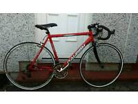 Red Raleigh road bike