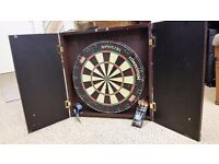 Full sized dart board with 2 sets of darts in attractive wooden enclosure with doors