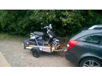 Car trailer for Scooters and smaller mortorcycles (125cc) Flat bed.