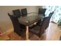 Glass table and 6 faux leather chairs