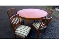 Extending dining table and four beautiful upholstered chairs