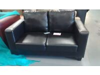 nearly new two seater leather sofa