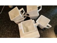 Set of square mugs and saucers