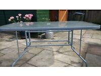Glass topped patio table with metal legs