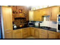Complete solid wood light oak shaker style kitchen with applicances