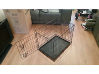 Two Dog Cages for sale.