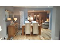 Extending oak affect dining table with x4 solid oak cream faux leather chairs