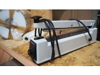 Heavy duty heat sealer with pouches