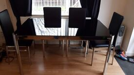 Dining table and chairs , and other black gloss lounge furniture