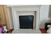 Granite fire place with wood mantle