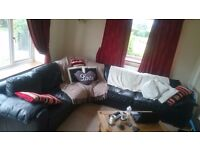 black leather seven seater sofa