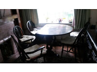 Folding Leaf Dining Table, and 5 chairs - Dark Solid Wood. Condition, used.