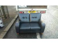 2 seater sofa in black leather £135 delivered