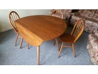 Ercol Style Drop Leaf table with 3 chairs.