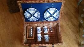 Vintage picnic hamper with plates mugs glasses
