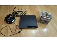 Boxed PS3 Slim with 14 games, 2 controllers