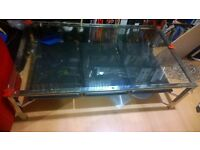 Solid Glass COFFEE TABLE with metal sides/ legs and black leather magazine inserts/racks