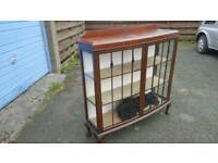 Antique bowfront display cabinet