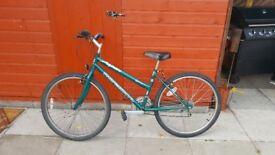 2 bikes for sale orange bmx $65 green gear bike $55