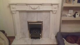 Cream/white marble fireplace