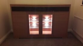 Oak sideboard with lit display area