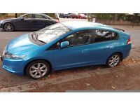 Blue Honda insight in great driving condition!!