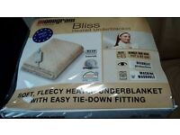 Single fleecy electric blanket. New and still in packing. Unwanted present.