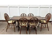 Ercol dark wood table and 6 chairs