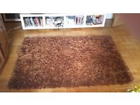 Handmade in india Mirage rug. Deep polyseter pile 6x4 colour ginger spice, in very good condition