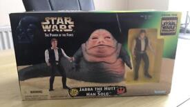 Jabba the hut and Han Solo figure