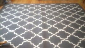 Extra large, large and low pile, dark grey rug