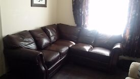 Premium leather corner-group sofa in good condition with some marks £150 retail price £1200